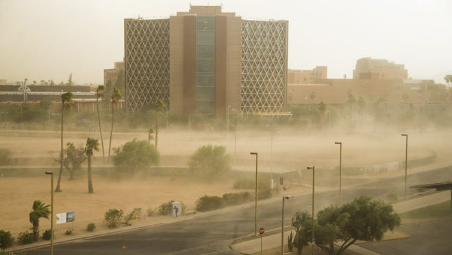 Dust blows near ASU's campus as a storm hits Tempe on July 9, 2018.