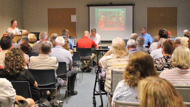 Residents of the Grandview division northeast of Marion listen to county officials during a public hearing on Wednesday that decided the fate of a $404,000 project to clean up the Beaver Seckel ditch.