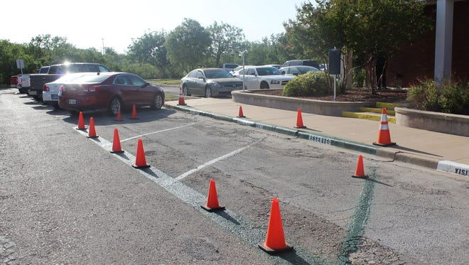 Cones and green paint mark he safe exchange zone set to open July 20, 2018 at the San Angelo Police Department, 401 E. Beauregard.