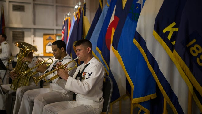 Members of the Navy Band Southeast play during a changing of command ceremony on Thursday, July 12, 2018, at the USS Lexington Museum on the Bay.