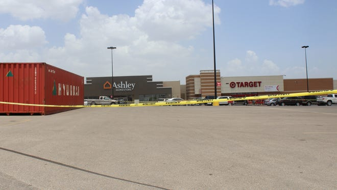 Yellow tape marking construction in the Target parking lot at 4235 Sunset Drive on July 16, 2018