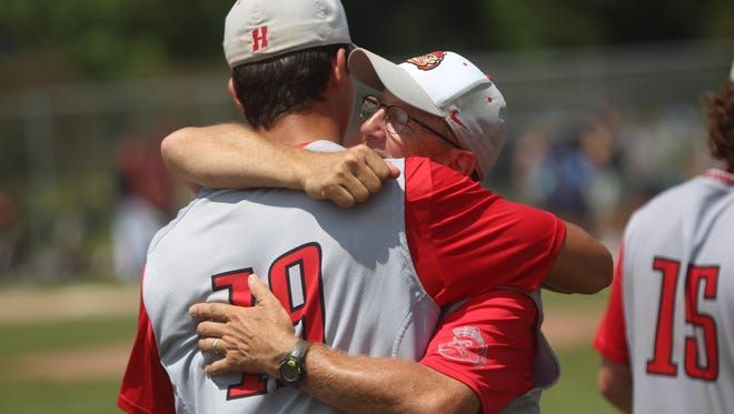Homestead head coach Ernie Millard hugs senior Jack Van Vooren after a sectional semifinal loss to Germantown. It was Millard's final game as the Highlanders coach after 26 seasons.