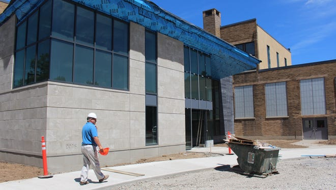 Commisioner of Public Works Paul Schenkel in front of the center's new entrance.