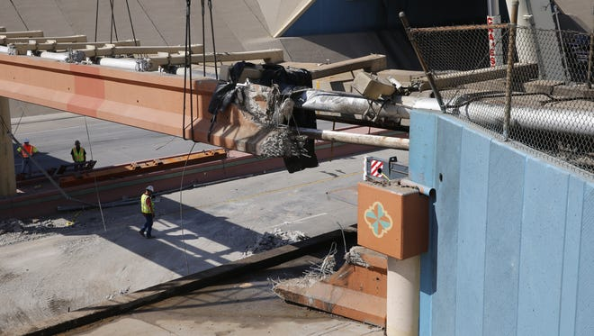 Crews work Friday morning to repair a Downtown utility overpass that was damaged Thursday in a fiery semitrailer crash that forced the closure of Interstate 10 in Downtown El Paso.