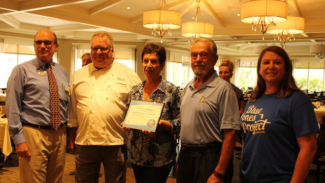 Employees at Vanderbilt Country Club celebrate the restaurant earning Blue Zones Project recognition.