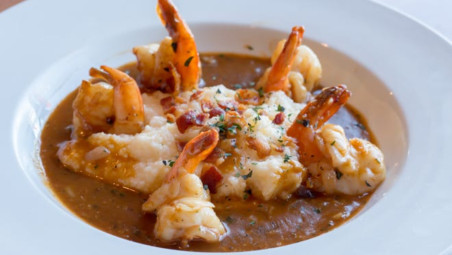 The Shrimp and Grits at Capt'n Butcher's Seafood Bar & Grill in Sebastian come with  red-eye gravy over cheese garlic grits topped with rendered bacon and chives.