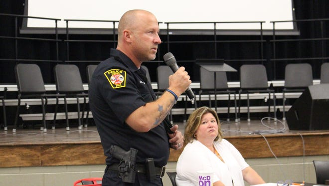 Officer Keith Swisher, shown here talking with the Madison school board in  July, 2018, was reinstated as Shelby's  School Resource Officer on Friday, a month after being placed on paid administrative leave.