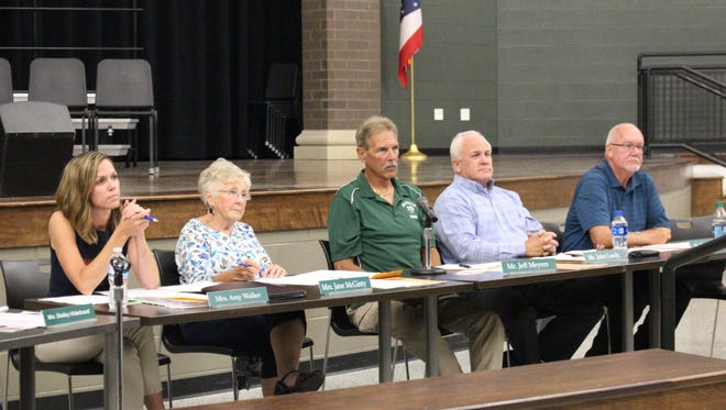 (From left to right) Madison school board members Amy Walker, Jane McGinty, Jeff Meyers, John Luedy and Tim Wigton listen to food service supervisor Diane Coleman's report Wednesday, July 25, 2018. Coleman said the district will no longer provide free breakfast to all students.