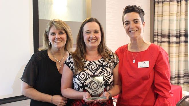 American Heart Association Volunteer of the Year Megan Farmer (center) with AHA/ASA Regional Director Gina Chapman and Event Logistics Coordinator Allison Mitura.