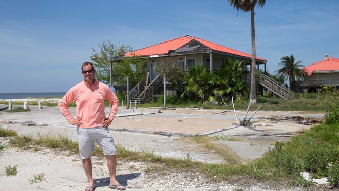 Brian Holden, the manager of the Redfish Lodge, stands in front of the slab that used to be his office that was destroyed by Hurricane Harvey on Monday, July 23, 2018 in Rockport.