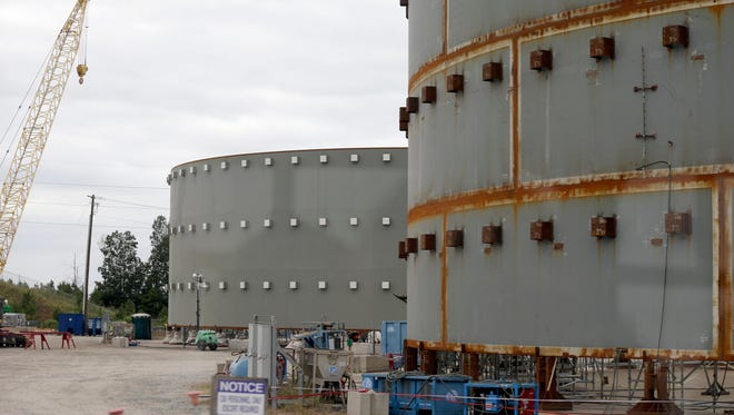 FILE - In this Sept. 21, 2016 file photo, parts of a containment building for the V.C. Summer Nuclear Station is shown near Jenkinsville, S.C., during a media tour of the facility.  South Carolina's utilities are abandoning two partly-built nuclear reactors. And they want permission to charge customers another $5 billion to cover their costs. An environmentalist says that money could have gone to renewable energy. Others say nuclear is key to cooling the planet and won't exist if the federal government doesn't finance it.  (AP Photo/Chuck Burton)