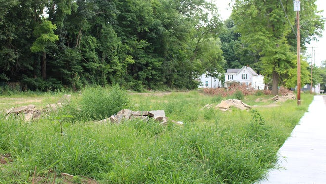A vacant lot in the 200 block of Ohio Street, seen here Wednesday, Aug. 1, 2018, previously housed three apartment buildings. The Richland County Land Bank plans to focus on redevelopment options for the site.