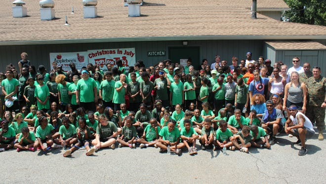On July 28, campers at Camp Kiddie Keep Well in Edisonenjoyed the U.S. Marine Corps Toys for Tots Christmas In July barbecue. The event was sponsored by Applebee's of Edison.