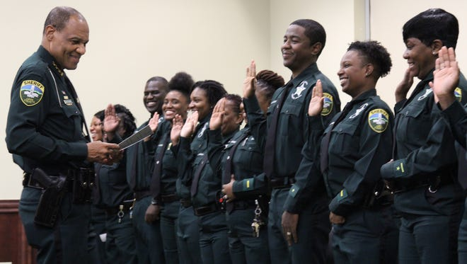 Leon County Sheriff Walt McNeil swears in correctional officers on Friday. Fifteen Leon County jail correctional officers and 10 sheriff's deputies joined the LCSO ranks.