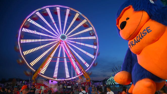 The Midway just after sunset at the NYS Fair. on Sunday, Aug. 27th 2017  in Geddes, N.Y.