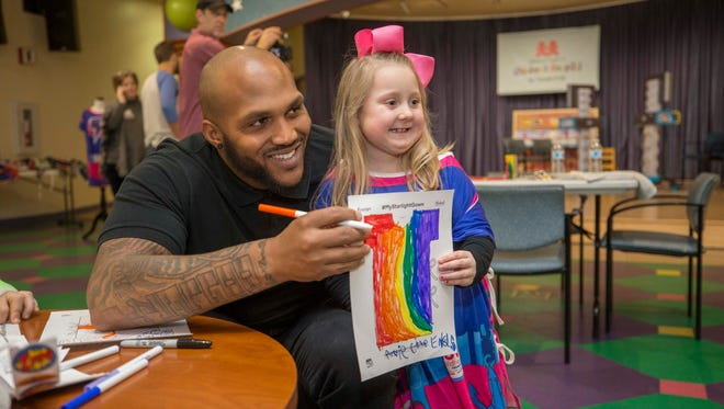 Titans defensive lineman Jurrell Casey with a young patient at Monroe Carell Jr. Children's Hospital at Vanderbilt in February.
