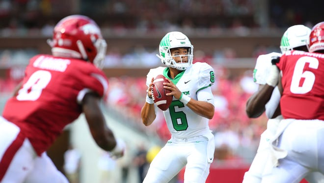 Mason Fine throws a pass during North Texas' victory at Arkansas earlier this year