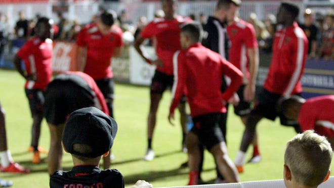 Kids watch the Phoenix Rising warm up before its playoff game against the Portland Timbers 2 on Friday night at Phoenix Rising Soccer Complex on Oct. 19.