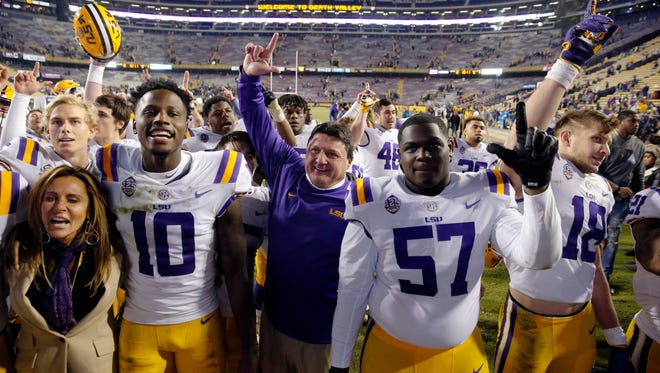 LSU coach Ed Orgeron sings the school alma mater with his team after an NCAA college football game against Rice in Baton Rouge, La., Saturday, Nov. 17, 2018. LSU won 42-10. (AP Photo/Gerald Herbert)
