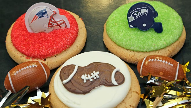 Pictured are the Deflategate and Super Bowl cookies made at Ryke's Bakery, Catering & Cafe in Muskegon on Tuesday, Jan. 27, 2015.