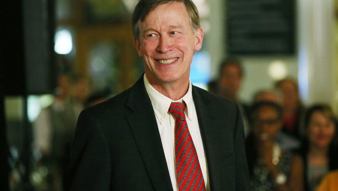 Colorado Gov. John Hickenlooper smiles as he speaks to supporters at election night gathering in Union Station in downtown Denver late on Tuesday, Nov. 4, 2014.