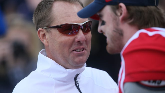 Ole Miss head coach Hugh Freeze talks with quarterback Bo Wallace prior to the game. Mississippi State played Ole Miss in a college football game on Saturday, Nov. 29, 2014 at Vaught-Hemingway  Stadium in Oxford, Miss. (Photo by Keith Warren)