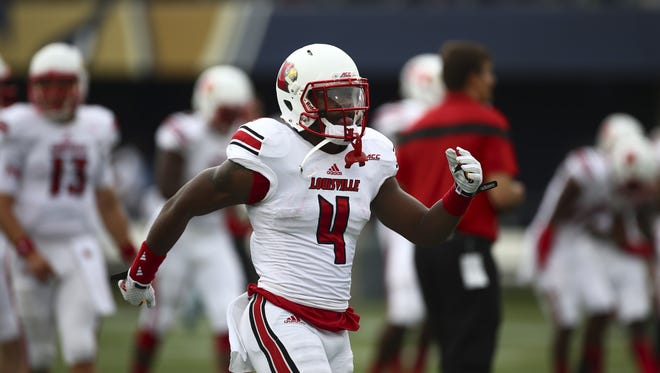 Louisville's Corvin Lamb (4) during the first half of a NCAA college football game in Miami, Fla., Saturday, Sept. 20, 2014 against FIU. (AP Photo/J Pat Carter)