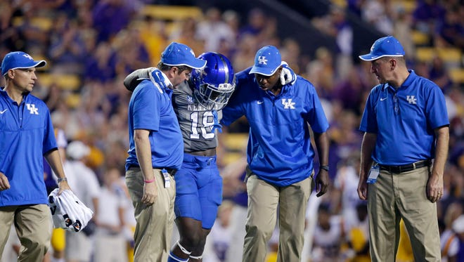 Medical personnel tend to injured Kentucky player  Stanley Williams in the second half of last week's game at LSU.