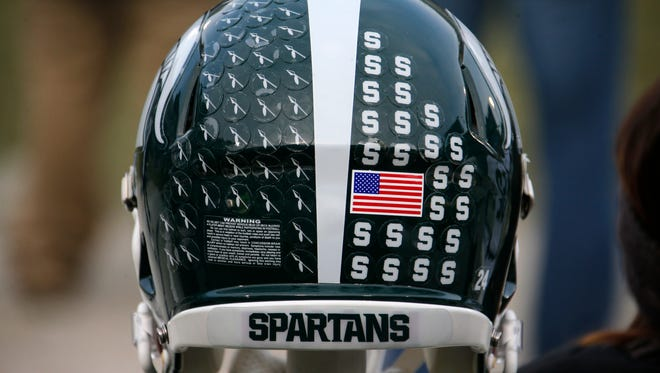 This is a Michigan State football helmet on the sideline before an NCAA college football game against Penn State in State College, Pa.