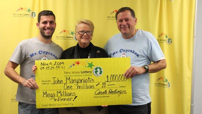 Johnny Manganiotis, left, founder of Mr. Cupcakes, with Carole Hedinger, executive director of the New Jersey Lottery, and John Manganiotis, Mega Millions winner.