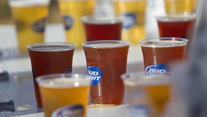 Beer is poorer and waiting for consumption during the Four Peaks Oktoberfest at Tempe Town Lake, Saturday, October 11, 2014, in Tempe, Ariz.