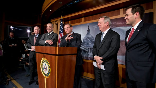 Three Republicans from the bipartisan group who wrote the 2013 Senate-passed immigration bill are asking President Barack Obama not to use his executive authority to take action on deportations. (AP Photo/J. Scott Applewhite)