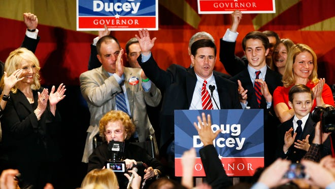 Republican Doug Ducey celebrates after winning the Arizona gubernatorial election on Nov. 4, 2014, at the Hyatt Regency in Phoenix
