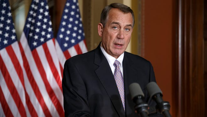 """House Speaker John Boehner of Ohio responds to President Barack Obama's intention to spare millions of illegal immigrants from being deported, a use of executive powers that is setting up a fight with Republicans in Congress over the limits of presidential powers, Friday, Nov. 21, 2014, during a news conference on Capitol Hill in Washington. Boehner, who has refused to have his members vote on broad immigration legislation passed by the Senate last year, said earlier that Obama's decision to go it alone """"cemented his legacy of lawlessness and squandered what little credibility he had left."""""""
