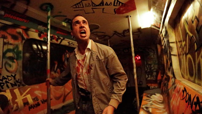 """An actor performs during """"Nightmare: New York,"""" a haunted house attraction in New York on Oct. 2, 2014. The """"Nightmare""""  Lower East Side house transports visitors to the city's """"bad old days,"""" including the demented rat-and-crime infested subway of the 1980s."""