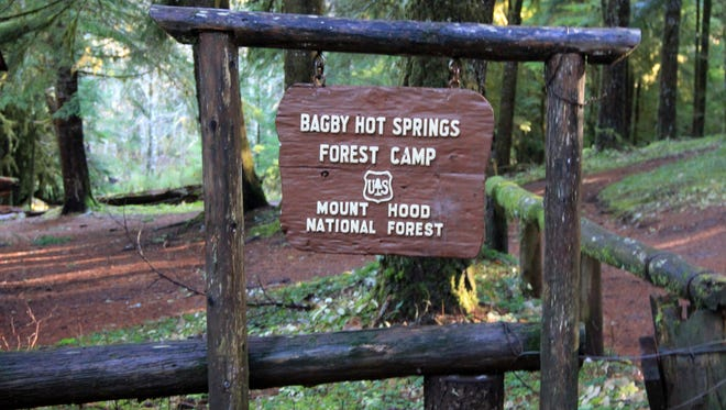 Signs keep visitors to Bagby Hot Springs informed on what to expect during a trip to these famed hot springs in Mount Hood National Forest.