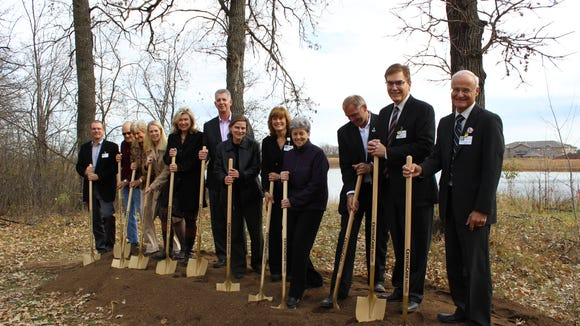 A groundbreaking ceremony was this week for Chateau Waters in Sartell. Participating were (from left) David Larson, director of facilities management, CentraCare Health; Darwin Bonn, St. Benedict's Senior Community operating committee member; Nancy Ferche, SBSC operating committee member; Alanna Carter, director of environments for aging, RSP Architects; Linda Doerr, vice president  of senior services, St. Cloud Hospital, CentraCare and CEO of SBSC; Bill Krake, president, Welsh Companies; Mary Degiovanni, Sartell city administrator; Robin Theis, administrator of housing and community services, SBSC; Sister Kara Hennes, OSB, coordinator of monastery health services at SBSC and St. Cloud Hospital board chairperson; Joe Perske, Sartell mayor; Craig Broman, president, St. Cloud Hospital; and Terry Pladson, president and CEO of CentraCare.