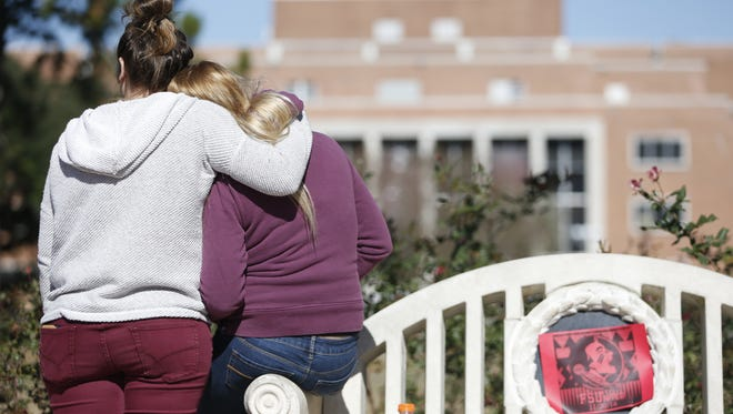 Students comfort each other after Wednesday night shooting