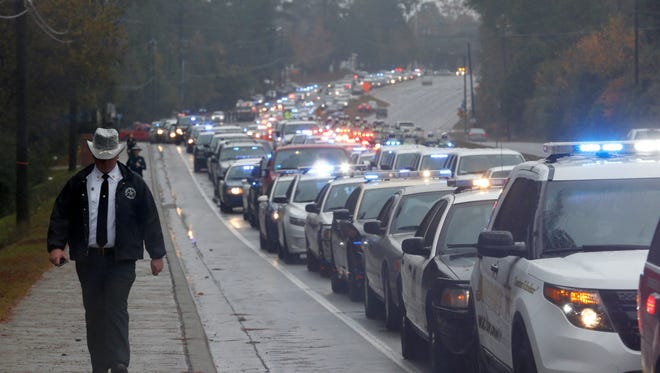 Joe Rondone/DemocratA line of law enforcement vehicles await the beginning of the funeral procession for Deputy Christopher Smith of the Leon County Sheriff's Office on Thomasville Road Tuesday.