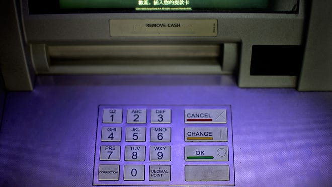 An ATM at a Wells Fargo bank in Atlanta. Hackers penetrated the computer systems of JPMorgan Chase, the country's largest bank, stealing names, e-mails, addresses and phone numbers over the summer.