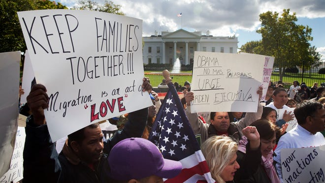 People rally for comprehensive immigration reform on Nov. 7, 2014, outside the White House. Immigration groups are pushing for executive action.