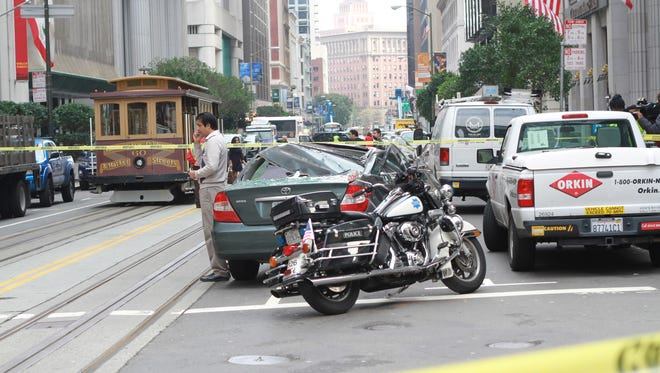 Police tape blocks the scene of an accident in San Francisco's Financial District when a window washer fell 11 stories and bounced off the roof of a passing car. The victim was in critical condition at San Francisco General Hospital.