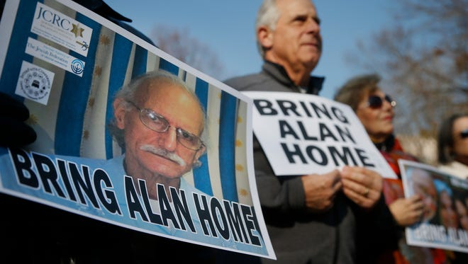 Supporters of U.S. contractor Alan Gross, on poster at left, protest in Lafayette Park, across from the White House in Washington, D.C., on Dec. 3, 2013. It was the fourth anniversary of Gross' imprisonment.
