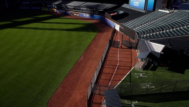 A white chalk line marks the location of the outfield wall at Citi Field during the 2014 season. The Mets are moving their fences in for the second time.