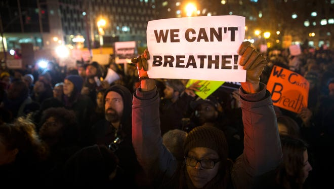 Demonstrators rally against a grand jury's decision not to indict the police officer involved in the death of Eric Garner, Thursday in New York. A grand jury cleared a white New York City police officer Wednesday in the videotaped chokehold death of Garner, an unarmed black man, who had been stopped on suspicion of selling loose, untaxed cigarettes.