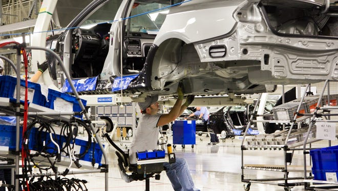 An employee works on a Passat at the Volkswagen plant in Chattanooga, Tenn. The UAW is trying to unionize the plant, which would be its first foreign-owned auto plant in the South.
