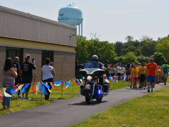 Vineland police lead the way along the route for the