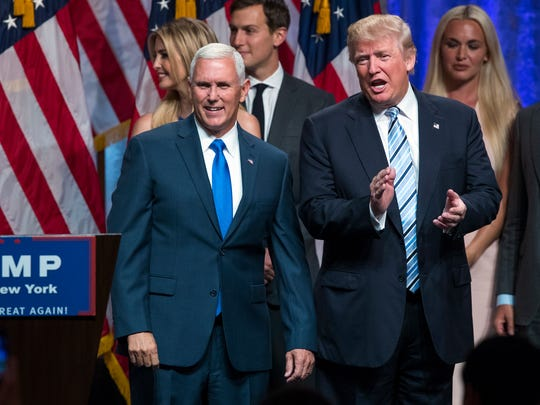 FILE PHOTO: Presidential candidate Donald Trump, right,