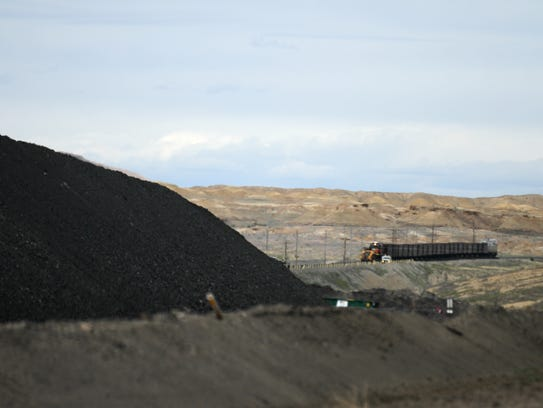 A train waits to pick up a load of coal, Wednesday,