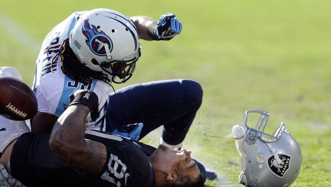 Titans S Michael Griffin is being penalized for this hit on Raiders TE Mychal Rivera.
